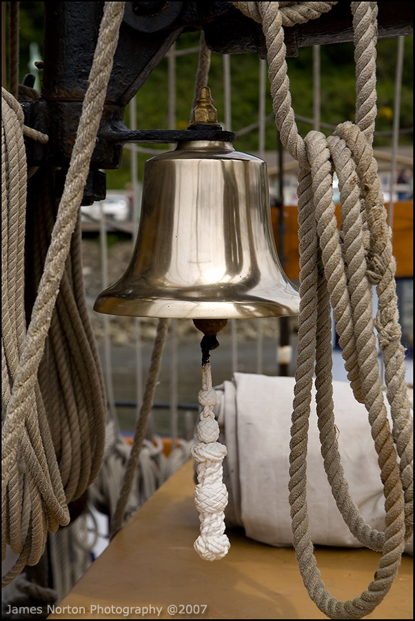 Maritime Bell on Old Wooden Boat